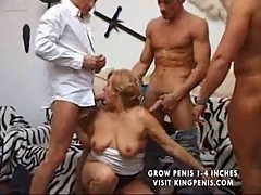 Hungry granny fucked by 3 cocks