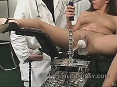 Sexy brunette fucks a machine as her pussy gets wet