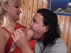 Blonde granny pampers self with young cock