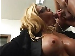 Blonde with massive oiled boobs and glasses does deep throat
