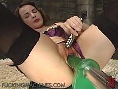 Fancy Looking Brunette Wears Stockings As She Plays With A Fucking Machine